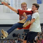Senior Jack Barickman gracefully swings senior Deegan Poores during the dance competition. Photo by Audrey Kesler