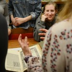 Senior Lilly Lyddon laughs at a joke while learning about ancient space models. Photo by Diana Percy