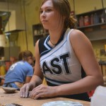 Senior Rachel Rogers rolls her clay on the work table for her project. Photo by Morgan Plunkett