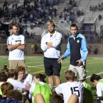 Head varsity boys soccer coach Jamie Kelly talks to the players during halftime. Photo by Katherine Odell