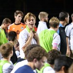 Junior Ian Schutt talks with some of his teammates on the sidelines. Photo by Katherine Odell