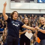 Seniors Peter Haynes, Morgan Biles, and Mazie Brook speak during the pep assembly about bringing cans for the can drive. Photo by Katherine Odell