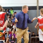 Mr. Haney, Mrs. Hallstrom, and Mr. Laird dance at the can drive pep assembly where they are competing in a dance competition against the other grades. Photo by Katherine Odell