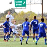 Senior Stanley Morantz heads the ball to keep it in bounds. Photo by Haley Bell