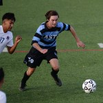 Senior midfielder, Will Krebs, races his opponent to the ball to gain possession. Photo by Kaitlyn Stratman
