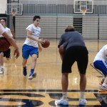 Seniors Stanley Morantz and Liam George cheer on their teammates as they run sprints while dribbling. Photo by Kaitlyn Stratman