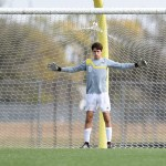 Junior Nick Gasperi warms up his arms, preparing for a penalty kick. Photo by Morgan Browning
