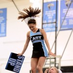 Junior Astrid Cifuentes finishes a stunt during while the cheerleaders perform a chant. Photo by Maddie Smiley