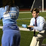 Senior Chace Prothe prepares to launch a T-shirt into the crowd at half time. Photo by Ellie Thoma