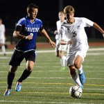 Senior Grant Roesner beats an Olathe defender to the ball. Photo by Ellie Thoma