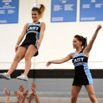 Senior Mallory Gray performs her stunt as she is launched into the air next to Junior Astrid Cifuentes. Photo by Ellie Thoma