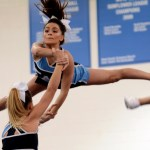 Junior Astrid Cifuentes flips over as she is stunted. Photo by Ellie Thoma