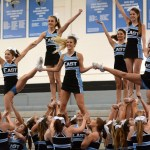 The competition cheer squad strikes a pose once in formation. Photo by Ellie Thoma