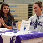 Senior Emma Henderson claps for Senior Ellie Braly as she is introduced to the crowd. She will be attending Kansas State University for rowing. Photo by Ellie Thoma