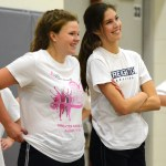 Sophomore Andie McConnell laughs with Junior Sophie Barecca  while waiting to join a drill. Photo by Ellie Thoma