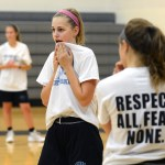 Sophomore Addie Von Drehle wipes sweat from her face with her shirt. Photo by Ellie Thoma