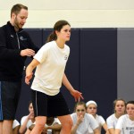 Coach Tj uses Junior Caroline Blubaugh to demonstrate proper defensive position. Photo by Ellie Thoma