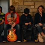 While waiting to perfom, the band Overland Park School of Rock sits and listens to the other performers. Photo by Ellie Thoma