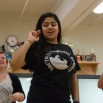 Sophomore Anika Radadiya shows the dance members the steps to the dance. Photo by Katherine Odell