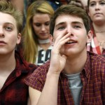 Seniors Aidan Hense and Chase Tetrick watch apprehensively to see who wins the tip-off. Photo by Diana Percy