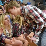 Senior Hailey Mohr convinces senior and yell leader Brayten Bowers to lead a certain cheer. Photo by Diana Percy