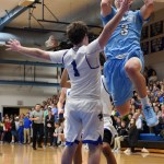 Senior Trevor Thompson shoots over the head of Rockhurst player Scotty Thompson. Photo by Diana Percy