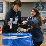 "Seniors Logan Cleaver and Teagan Noblit participate in the class relay race to encourage students to donate to ""Giving the Basics"", a foundation that provides basic hygiene products to those in need. Photo by Diana Percy"