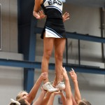 Junior Astrid Cifuentes in stunted into the air as the varsity line up is announced. Photo by Ellie Thoma