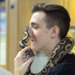 Junior Jarrett Zeliff carries a boa constrictor during a presentation. Photo by Ty Browning