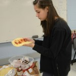 Sophomore Lucy Hoffman makes a jelly filled crêpe. Photo by Grace Goldman