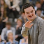 After telling a joke to the Lancers at the pep assembly, sophomore Jack Melvin waves at a friend in the crowd. Photo by Grace Goldman