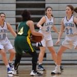 Sophomore Alex Como and Freshmen Annie Barreca and Megan Funkey try to grab the ball. Photo by Reilly Moreland