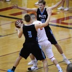 Seniors Liam George and Trevor Thompson  guard an opponent near the Indian's basket. Photo by Kaitlyn Stratman