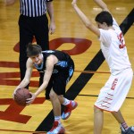 Sophomore Noah Kurlbaum attempts to keep the ball in play after swatting it off the rebound, but steps past the baseline. Photo by Kaitlyn Stratman