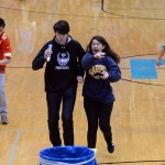 Seniors Logan Cleaver and Teagan Noblit take the lead in the three-legged race. Photo by Kaitlyn Stratman