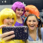 Juniors Maddie Smiley and Savanna Worthington, and sophomores Maggie Mulligan and Megan Walstrom take a selfie in costume before the run-through. Photo by Izzy Zanone