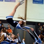 Sophomore Emma Kerwin completes a flyover with her stunt team during their performance. Photo by Izzy Zanone