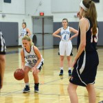 Sophomore Lauren Sandow takes her free throw, as all her team mates wait to get the rebound.  Photo by Morgan Plunkett