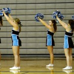 Shawnee Mission East freshman cheerleaders cheer on the Boys Freshman-A basketball players. Photo by Luke Hoffman