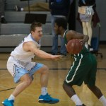 Senior Trevor Thompson guards his opponent from Kansas City East and tries to steal possession of the ball. Photo by Katherine Odell