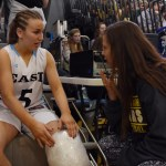 Senior Kyle Haverty discusses her injury with a South student before the boys' game. Photo by Diana Percy