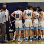 The JV boys huddle up during a timeout just before halftime. Photo by Laini Reynolds