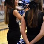 Junior cheerleader Chloe Kowalski cheers after senior Trevor Thompson scores a layup in a the third quarter. Photo by Lucy Morantz