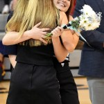 Junior Lilly Horton hugs a junior cheerleader as she runs out to give Lilly her flowers for Senior Night. Photo by Lucy Morantz
