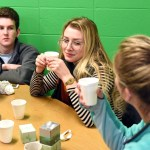 Drinking the flower tea they just prepared, Seniors Joey Gasperi, Sarah Milgrim and Emma Stanford take a break and chat. Photo by Ellie Thoma