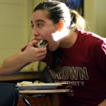 Junior Ellie Van Gorden digs into her first attempt at making sushi. Photo by Ellie Thoma