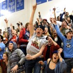 The student section goes wild as East is announced the winner of the Giving the Basics challenge. Photo by Ellie Thoma