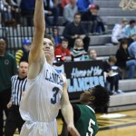 Senior Trevor Thompson goes in for a layup and scores. Photo by Haley Bell