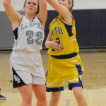 Sophomore Andie McConnell attempts to shoot, but her opponent blocks it. Photo by Ellen Swanson