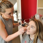 Sophomore Holly Frigon does sophomore Chloe Wright's makeup in preparation for WPA. Photo by Grace Goldman